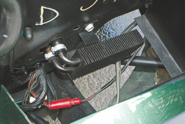 1967 saw, for the first time ever on a Shelby Mustang, the use of a power steering fluid cooler (likely because 1967 saw the first-ever use of power steering on a Shelby). The former 1965 Galaxie part was mounted to the front side of the radiator support behind the driver's side parking light