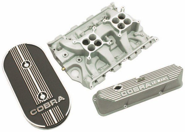 Aluminum work of the 428 included bare finish Shelby COBRA LEMANS valve covers, a Ford dual-quad aluminum intake manifold and a COBRA cast oval air cleaner to top off the twin Holleys.