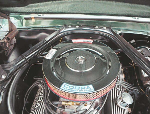 For 1967, the single-piece cowl-to-shock-tower export brace replaced the standard Mustang's multiple-part struts. The 1967 (and 1968) export braces had attaching holes that matched the bolt holes in the Mustang's firewall, so the additional firewall stiffener plate wasn't needed (as it was in 1965 and 1966). Most 1967 Shelbys used hood springs to hold the hood open, smaller in diameter than the standard Mustang's due to the fiberglass hoods' lighter weight.