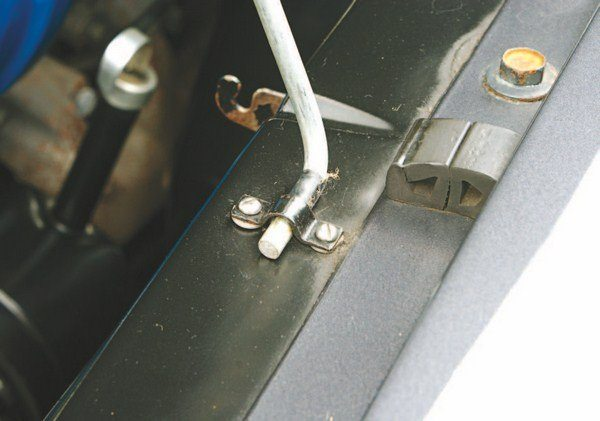 Some early cars used a Falcon prop rod in lieu of springs on the hinges to hold the hood open. Semicircular brackets on the bottom of the hood and the inner fender captured the ends of the rod.
