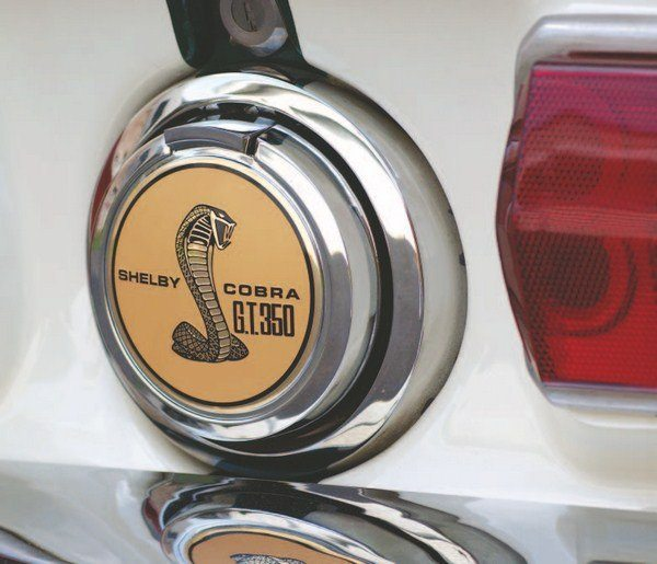 Early caps (left) had an adapter that allowed mounting of a flat COBRA decal on the otherwise-domed face of the cap whereas later caps (right) were simplified with a convex-shaped decal applied directly to the domed surface of the gas cap. While production GT350s were built with both types of caps, with the exception of the prototype GT500 and perhaps a couple of other engineering cars, no production GT500s were built with the early flat style of gas cap. The switch to the domed type was made before production GT500s began rolling off the line.