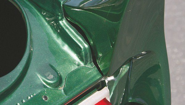 "Presumably the third and final iteration of tail panel (""presumably"" is used because there could have been other types of panels with slightly different design features that were used on very limited numbers of cars) featured an enlarged lip that was riveted to the crosswise rail of the trunk opening. This must have been the silver bullet as far as both water sealing and attachment was concerned as it was the mounting method used on the 1968 Shelby tail panels."