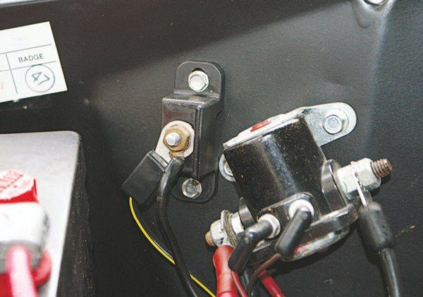 A junction block was used to tie in the underdash ammeter to the electrical system. Early blocks (molded in light gray Bakelite; left) were an aviation industry component, while 1965 Lincoln parts (right) were used on later cars.