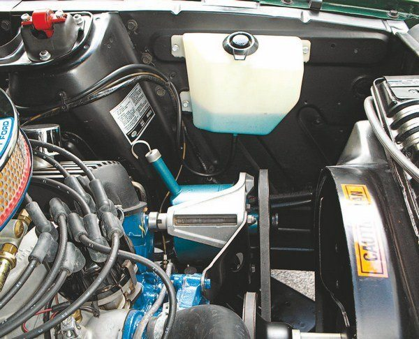 Early 1967 Shelbys (both GT350 and GT500) can be so identified by the windshield washer reservoir bag where later cars had a molded plastic tank. The changeover didn't have anything to do with Shelby American, but was rather made by Ford in the middle of Mustang production. Nevertheless, it serves as a good identifier of the early or late Shelby cars.
