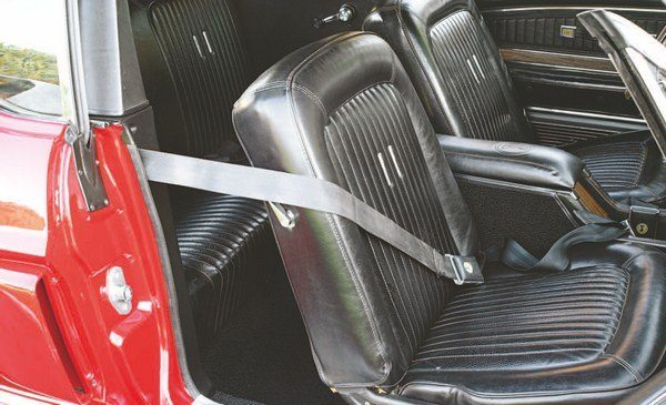 The cross-chest shoulder strap that debuted in the 1968 Shelby convertible was an excellent example of function following form. The appearance of convertibles with shoulder belts dangling from the roll bar was felt to detract from the appearance of the car with the top down, so Shelby engineering was directed to devise a cross-chest strap for convertible use. If that didn't work, a detachable roll-bar strap was deemed also desirable, but, in the end, converts got the cross-chest strap and hardtops got detachable roll bar harnesses