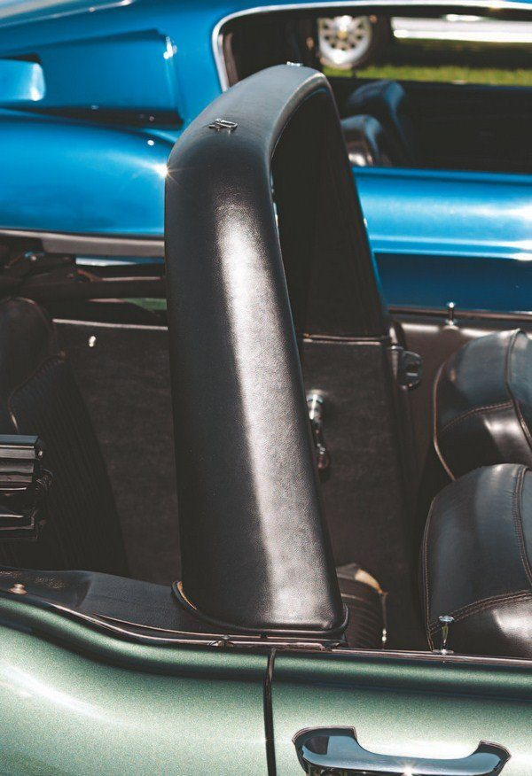 The tubular steel roll bar was covered with a thick rubber padding that provided bump resistance for the rear seat passengers and also gave the car a targa-like appearance with the top down. The roll bar extended down to the floor inside the interior trim panels. Fastbacks received tubular bars covered with padding that kept their round cross section.