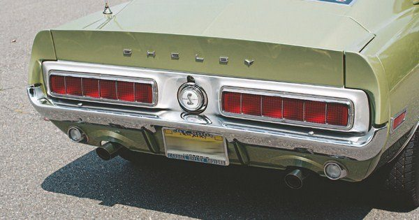 Tail panel T-Bird taillights coupled with a molded taillight panel and a spoilered deck lid gave the 1968 Shelby a unique look that was reminiscent of the 1967 Shelby, but visually distinct from the 1968 Mustang. S-H-E-L-B-Y lettering (the same letters as were used on the nose) broke up the starkness of the deck lid rear face. All 1968 tail panels were painted silver.