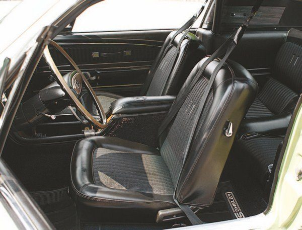 As in 1967, the 1968 Shelby interior was based on the deluxe Mustang cockpit. Deluxe 1968 seats lacked the stainless steel trim and hard plastic backs of the 1967 units. Two chrome trim pieces adorn the center of the seat back (only one was there in 1967), which proved to be a rude awakening to any shirtless driver climbing aboard on a bright sunny day. The shoulder harness was the same basic type as in 1967 (albeit with some slight differences).
