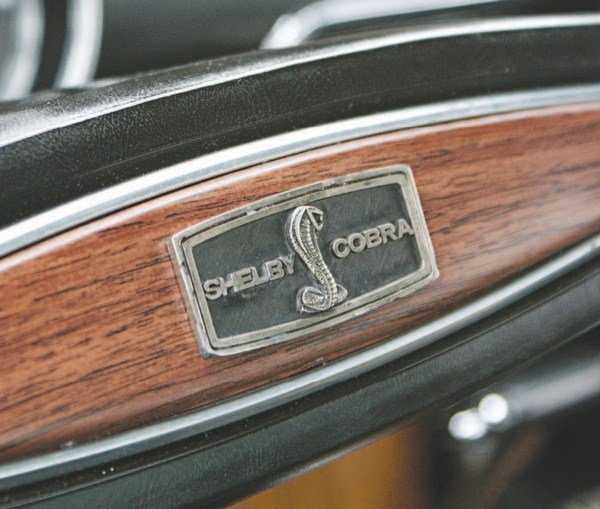 Located in the center of the two-spoked Mustang steering wheel is a SHELBY COBRA snake badge.