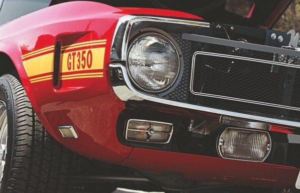 The front end of the 1969 Shelby shared nothing with the Mustang on which it was based. Fenders, hood, grille, bumper, and lower valance panel were all Shelby-unique. Lucas driving lights were mounted below the rather unsubstantial bumper, and 1969 Cougar parking lights were suspended under the headlights.