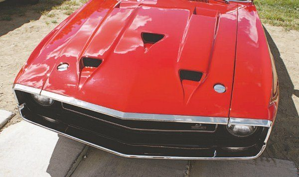 """Carroll Shelby once quipped that """"too much was just right,"""" and that design philosophy seemed to apply to the hood of the 1969 Shelby. If one air intake was good, three would be even better. The fiberglass hood was populated by a trio of flush NACA-type intake ducts and, when added to two hot air outlets, the hood had not many fewer openings than the typical miniature golf course."""
