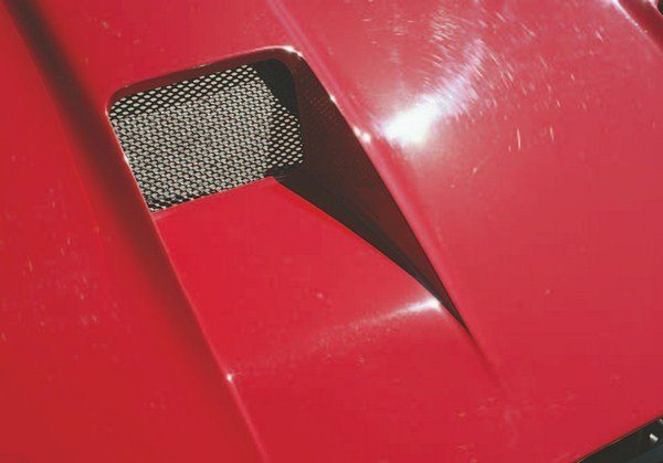Just as what goes up must come down, in the case of engine air, what goes in must also come out. Warm air from the engine compartment was exhausted via a pair of outlets directly behind the air intakes. Like the trio of air intakes, screen mesh also covered the dual-exhaust openings.