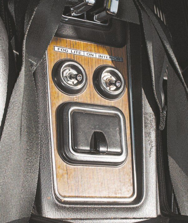 """The rear portion of the center console contained switches for fog and interior lites (note abbreviated spelling of """"lights""""). Although the lights were actually highintensity driving lights, they were labeled as fog lights."""