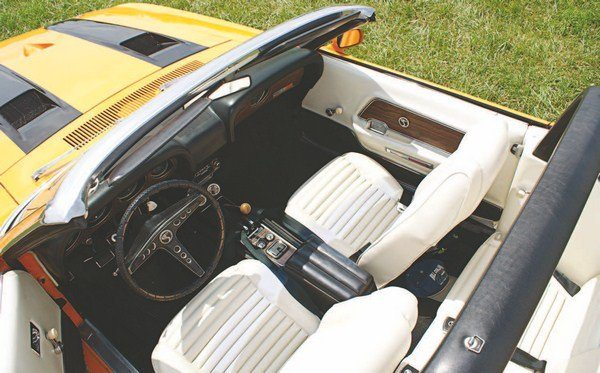 Continuing the practice started with the 1967 Shelby, a lightcolored interior option was also offered for 1969; white was the available color this year. Unlike in 1968, however, where the entire light interior (Saddle, then) was the same color, the 1969 light interior used a black dash, carpeting, and lower door panels. Only the seats, rear side panels, and upper door panels were white. The surfboard attaching loops atop the padded roll bar were carried over from the 1968 Shelby convertibles.