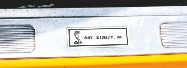 """A tag with """"Shelby Automotive, Inc."""" lettering was attached to the door sill scuff strips. The same basic snake graphic was used since it first appeared on 1967 door sill tags, and 1969 was the only year Shelby utilized the same doorsill label style throughout the entire year's production."""