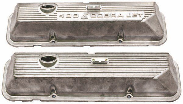 With both engines using the Ford-supplied ram air intake and air cleaner, the only Shelby-unique additions to the GT350 and GT500 engines were black die-cast COBRA valve covers on GT350s (left) and either bare aluminum COBRA JET or plain valve covers on GT500s (right).