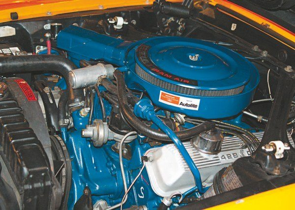 """Compared to earlier Shelbys, very little """"Shelbyization"""" was done in the engine compartment of the GT350 (left) and GT500s (right) except for aluminum valve covers; GT350s did use a cast-aluminum SHELBY-lettered intake."""