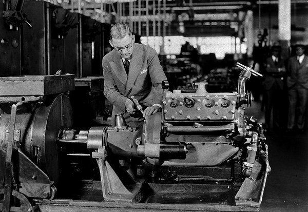 W. R. Campbell, president of Ford Motor Company Canada, stamps the first V-8 produced in Windsor, Ontario. Note the early long-neck water pumps. Canadian blocks were produced until 1954, as were Australian blocks. (Photo Courtesy Fordimages.com)