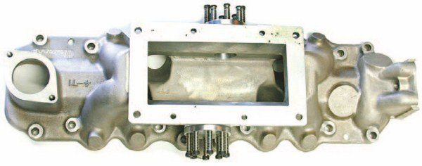 Navarro's blower intake was designed for the 4-71 GMC blower. With a collar spacer, it can accommodate other types of blowers. It features dual pop-off valves set at 15 psi.