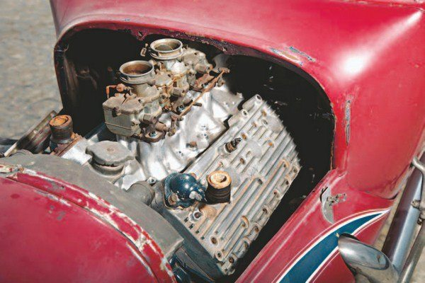 When Ray acquired the car, it was still fitted with its 8BA flathead, but a few parts were missing. Nevertheless, it had Sharp heads, a Navarro intake, and three Stromberg 97s. Not a bad place to start. (Photo by Tim Sutton)