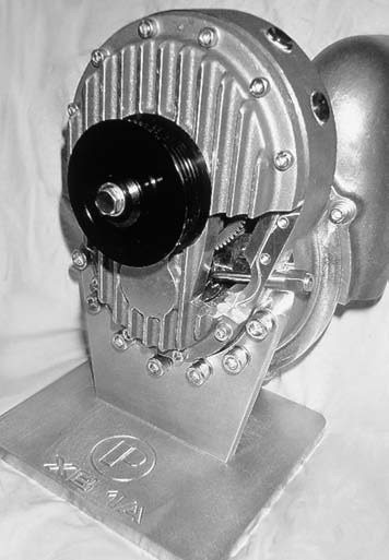 This cutaway view of the oil-fed Powerdyne XB-1A Series blower clearly shows the unit's helical-cut gearbox. It is capable of producing up to 18 psi, and the XB-1A is also available in reverse rotation, the XB-1AR.