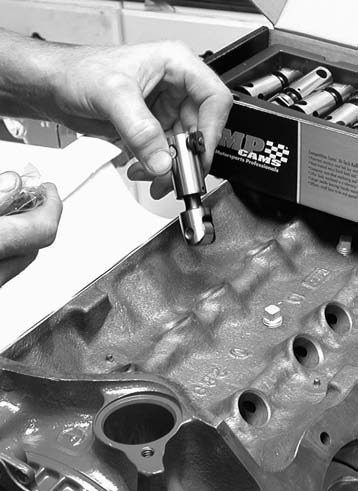 12. With the block flipped back over, it's time to install the Comp Cams roller lifters using plenty of assembly lube.