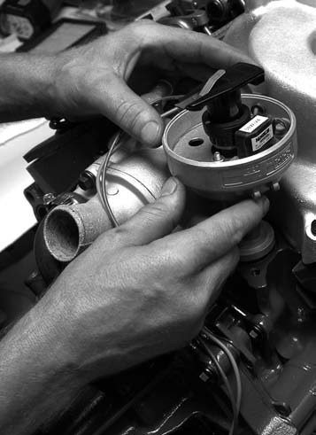 16. The Pertronix-Ignitor-equipped Ford distributor is installed using the provided ARP distributor bolt and factory hold down. When the system is final-tuned, it is set at 34 to 36 degrees total advance.