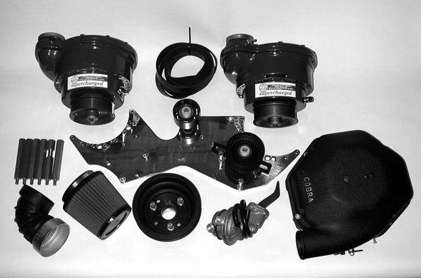 Shown is Paradise Paxton's Two-Stage Deluxe SN-60-based twin supercharger kit for 1964 1/2 to 1970, 260 ci to 302W-equipped Mustang and Shelby small-block Ford V-8 engines. This kit features two internally updated SN-60 Paxton superchargers, a heavyduty 5⁄8-inch aluminum mounting plate, a cast-aluminum two-stage air box, an 8-rib serpentine crank pulley, a high volume mechanical fuel pump, K&N Lifetime conical air filter and air filter mounting bracket, and all the necessary hoses, supercharger mounting plate mounting studs, and bolts.