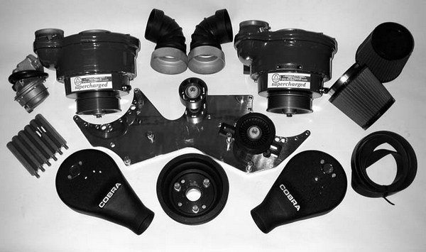 Shown here is Paradise Paxton's straight blow-through design deluxe SN-60-based twin supercharger kit for 1964 1/4 to 1970, 260 ci to 302W-equipped Mustang and Shelby small-block Ford V-8 engines.