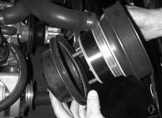 3. This is a simple procedure, and pulley mounting is accomplished by substituting the series of three OE 3⁄8-inch factory bolts with three 3⁄8-inch-long Allen-head bolts provided in the kit.