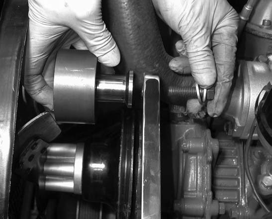 11. The supercharger idler pulley is mounted to the mounting plate using a 1⁄2-inch bolt.