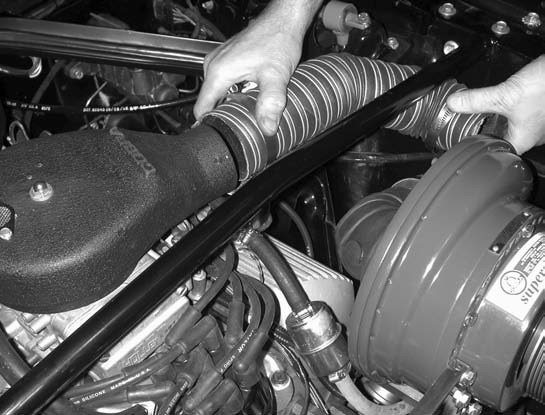 15. This is followed with installing the forward blow-through bonnet and hose assembly.