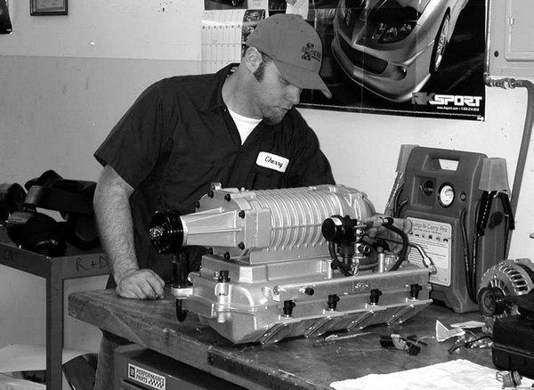 """Magnuson Products Inc. is world renown for building what many refer to as """"an Eaton with an attitude."""" In this photo, a Magnuson technician is photographed running a volt check on either a Gen IV or Gen V Eaton/Magnuson bypass actuator solenoid to ensure that the unit is fail-safe."""