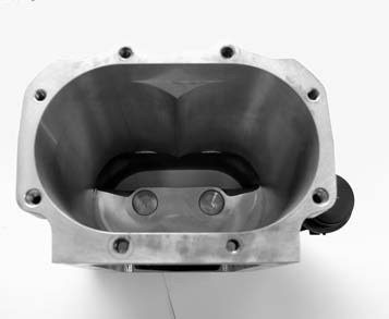 The Eaton/Magnuson supercharger housing is manufactured in-house at Magnuson Products. Note the finish on the inside of the case. The machining on these cases is VERY proprietary, and Magnuson is one of two facilities in the United States licensed by Eaton to do the job.