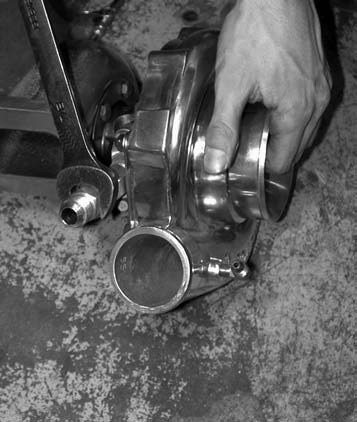 2. Next comes installing the AN-10 oil drain fitting, which is installed to the turbocharger housing using a 7⁄8-inch wrench.