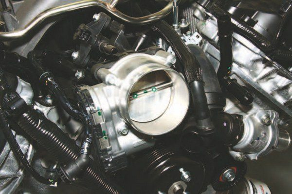 Here's the Coyote's standard 80-mm throttle body, which is located at the front of this state-of-the-art intake manifold. The throttle body is modulated by a geared motor drive that is controlled by the PCM.
