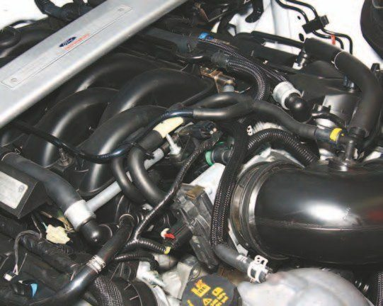"""The 5.2L """"flat-plane"""" V-8's induction system is completely different from its 5.0L sibling's. This is an engine designed for high-RPM operation, which makes low- to mid-range torque rather lackluster. But who cares? This is an ultra-high-performance V-8 developed for the racetrack and canyon cutting, not grocery getting. However, if your plan is to buy groceries, this guy does it quickly."""