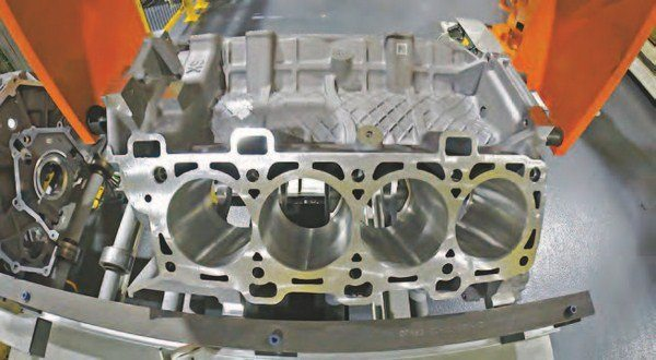 This is the 5.2L Shelby GT350 block during manufacture. What makes the 5.2L block innovative is Ford's patented Plasma Transferred Wire Arc (PTWA) cylinder-liner technology. This process eliminates typical heavy iron cylinder liners with a deposition process. This is the 5.2L block in manufacture prior to the PTWA cylinder-liner process. (Photo Courtesy Ford Performance Parts)