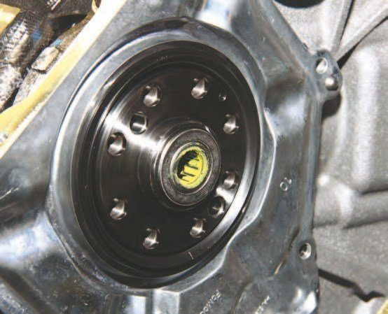 Here's the Coyote's cast-aluminum rear main seal cover, which makes rear main seal replacement easier than ever. It is suggested you use Permatex's The Right Stuff in an extremely thin film around the perimeter during installation. Use a generous amount of engine assembly lube or SAE 30–weight engine oil around the inside lip. The inside lip is pointed toward the crankshaft, never away.
