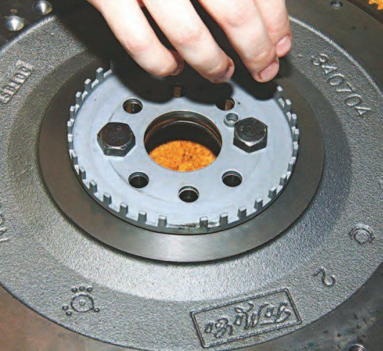 This is the crankshaft reluctor wheel, which is installed between the flywheel/flexplate and crankshaft. The shutter wheel for the pick-up sensor for the PCM is positioned at the back of the engine block. Both are accessible with the transmission removed.