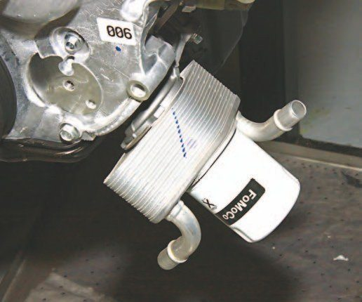 The 2015–up oil-to-water cooler installed on every factory 5.0L Ti-VCT engine (including the Ford Performance and Roush Aluminator crate engines) improves cooling. Although the oil filter mount/ adaptor is different (oil drainback hole) and cannot be interchanged between 2011–2014 and 2015– 2016, the oil-to-water cooler goes between the adaptor and oil filter and is interchangeable.
