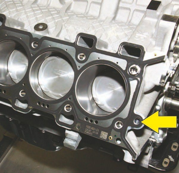 This oil galley passage (arrow) uses a restricted head gasket passage for 2011–2014. For 2015–2016, it is unrestricted as shown here on a production 2015 Coyote engine
