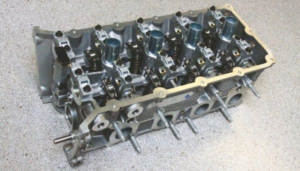 The revised 2015 head from the exhaust port side. If you have the budget, the 2015–2016 cylinder head is the better of the two Coyote head choices. Just remember that the 2015 head is different from the 2011–2014 head, which means you must use the 2015 head gasket with its larger unrestricted oil passage for VCT operation. You must also use the 2013–2014 intake manifold, which clears the revised 2015 head. The 2011–2012 intake manifold does not fit.