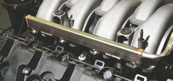 This is the right-hand-side (passenger) fuel rail with four Bosch EV14/US Car injectors. The aftermarket, specifically BBK and Summit Racing Equipment, offers a wealth of billet aluminum fuel injector rails for the Coyote if you seek improved heat dissipation qualities and good looks.