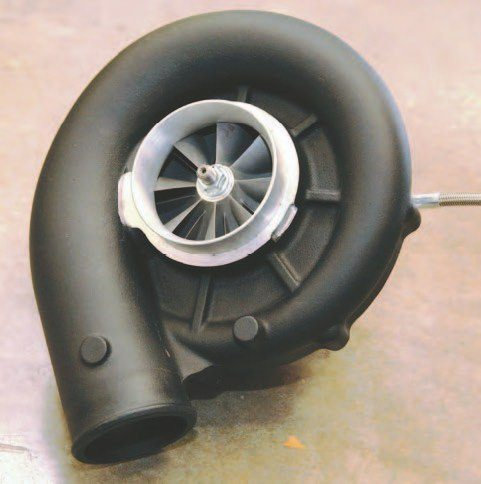 Here's the Vortech V-3 Si blower as a standalone. You do have a choice of three basic Vortech blowers depending on how much power you want and how much boost your Coyote can stand. And don't kid yourself, the V-3 Si has plenty of huff for a stock Coyote and you can expect 600 to 630 hp from this supercharger. However, power comes at a price. If you plan on pushing your engine above 600 to 630, understand the failure risk. When you get beyond these numbers, you need H-Beam rods and forged pistons. (Photo Courtesy Christopher Campbell)