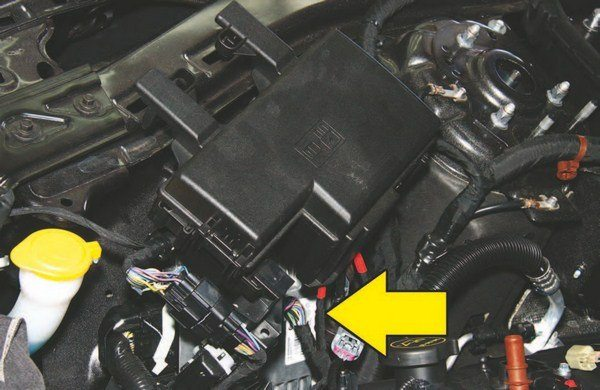 The Coyote's electronic engine control, known as Copperhead, is located closer to the engine these days instead of being inside the cabin. Access and service are easy. For 2011–2014 Mustang GT the PCM/ECU is located in the cowl behind the battery. For 2015-up it is located in front of the engine compartment on the right-hand side. Electrical systems have become more modular in nature, which means plug and play for ease of maintenance and durability.