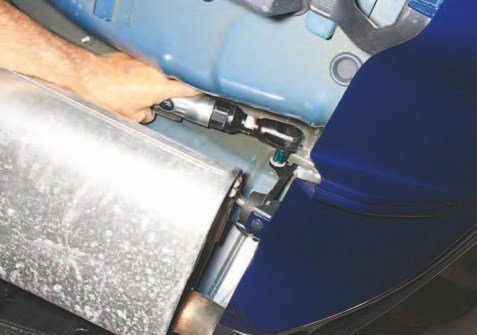 Mufflers are secured with two soft-mount brackets each, like this. It's a good idea to take pictures of your system before removal. It is easy to get these brackets backward when it's time to reinstall. Mufflers and pipes do not line up if you install these brackets backward.