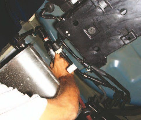 It is remarkable how easy these mufflers are to remove. As with the Ford Performance 2011–2014 exhaust system just mentioned, aerospace pipe clamps make it easy to disconnect mufflers and pipes and install new.