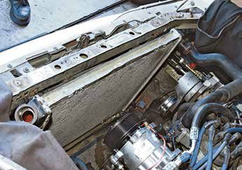 In the 1980s, Ford became more concerned with vehicle weight and cooling capacity. This is an original-equipment crossflow aluminum radiator in a 1989 Mustang GT with 5.0L High Output power. There's still room for improvement here with a good aftermarket aluminum radiator.
