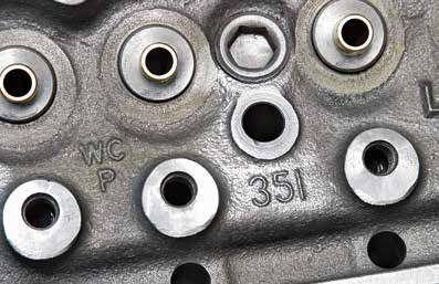 "A closer look at the 1975 351W head casting shows the ""WCP"" and ""351"" markings. When you are shopping for 351W cylinder heads, focus on 1969–1974 castings with the 60-cc chamber and 1.840/1.540-inch valves. By 1978, the 351W head was noth-ing more than a 302 casting with smaller 1.780/1.450-inch valves. A popular misconception is that the 351W head has larger ports. In reality, port sizing is the same as on the 289/302. Only valves are larger through 1977."